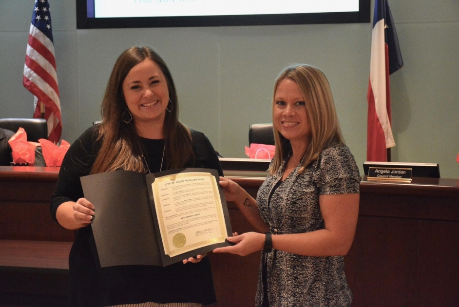 City Council Member Misty Songe presents VISD's Heather Watson with Red Ribbon Week Proclamation.