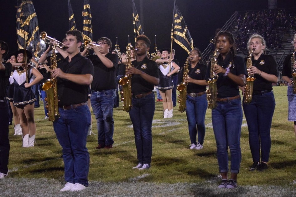Members of the Vidor High School band and drill team entertain the crowd at Pirate Stadium