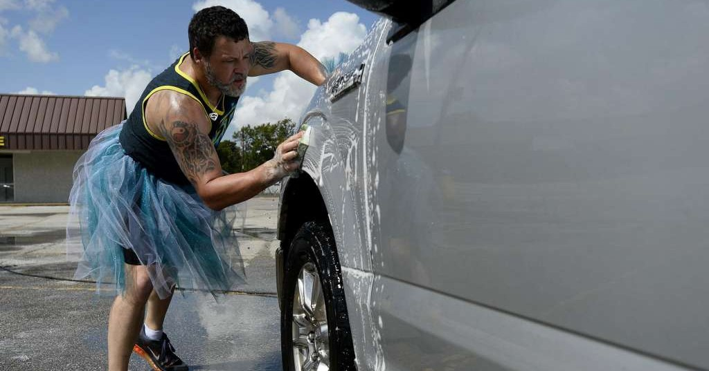 Vidor group dons colorful tutus for car wash